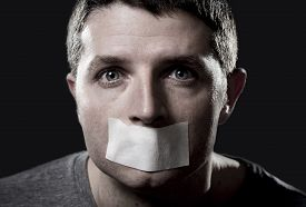 pic of freedom speech  - attractive young man with mouth and lips sealed on tape to prevent from speaking free keeping him mute and censored in freedom of speech and expression concept - JPG