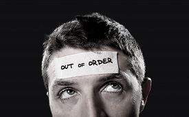 image of cognitive  - young man with blue eyes and tape text out of order on forehead in empty mind and blank brain concept lack of ideas creativity and mentally tired overwhelmed and stressed - JPG