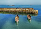 pic of outboard  - Rowing boats beside harbour in Dalkey Co - JPG