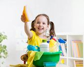 stock photo of cleanse  - Joyful kid little girl cleanses a floor in nursery - JPG