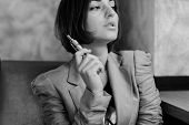 picture of electronic cigarette  - beautiful elegant young woman smoking electronic cigarette - JPG