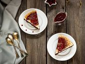 stock photo of cheesecake  - cheesecake with cherry sauce in vintage style on wooden table - JPG