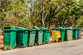 picture of recycle bin  - Row recycle bins in forest stock photo - JPG