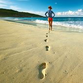 foto of footprints sand  - Woman at beautiful beach at Seychelles walking on sand - JPG
