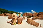 stock photo of couple sitting beach  - Couple sitting on a tropical beach at Seychelles - JPG