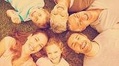 picture of extended family  - High angle portrait of an extended family lying in circle at the park - JPG