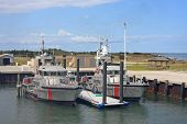 foto of outboard engine  - coastguard boats moored in Hatteras harbour - JPG