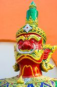 pic of sukkot  - formidable statue at the entrance of a Buddhist temple - JPG