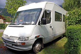 picture of camper  - camper van parked in a camp site - JPG