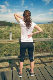 picture of jury  - Back view of athletic young woman in sportswear juries concept - JPG