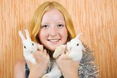 picture of tawdry  - teenager girl in tinsel with two pet rabbits - JPG
