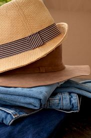 stock photo of apparel  - Fashion Torn Jeans and Leather Hat - JPG