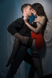 image of short legs  - Couple kissing passionately - JPG