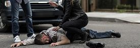 stock photo of accident victim  - Woman is helping victim of car accident - JPG