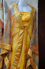 pic of dress mannequin  - Traditional silk robes and dress hanging on a mannequin in Tongli Town in Jiangsu Province China - JPG