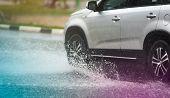 Car Rain Puddle Splashing Water poster