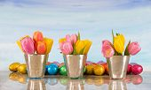 easter tulips in vases with foil wrapped eggs