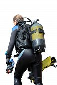 Diver With Dive Equipment Returning Of The Sea