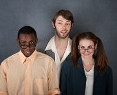 image of bifocals  - Mixed group of geeks on gray background smiling - JPG