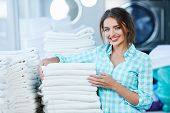Woman Near Heaps Of White Clean Linen poster