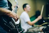 Behind Scene. Rock Band Practice In Messy Recording Music Studio poster