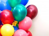 Colorful balloons on white background - with room for text