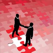 Business people partners agree and shake hands on solution to problem puzzle