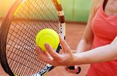 Female tennis player with racket ready to serve a tennis ball  poster