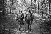 Two Re-enactors Dressed As World War Ii Russian Soviet Red Army Soldiers Marching Through Forest. Ph poster