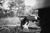 Hidden Re-enactor Dressed As German Wehrmacht Infantry Soldier In World War Ii Aiming A Russian Sovi poster