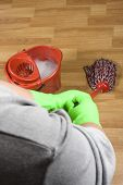picture of dust mites  - cleaner is mopping a wooden parquet floor - JPG