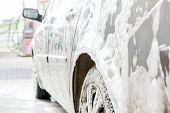 Car Wash With Foam In Car Wash Station. Carwash. Washing Machine At The Station. Car Washing Concept poster