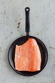 Big Raw Salmon Steak In Frying Pan On Rustic Table