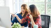 Two Young Asian Women Working With Computer At Home Office With Happy Emotion, Working At Home, Smal poster