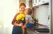 Happy Mothers Day! Child Son Gives Flowersfor  Mother On Holiday poster