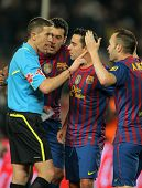 BARCELONA - JAN, 15: FC Barcelona players talk with the referee Iglesias Villanueva during the Spani