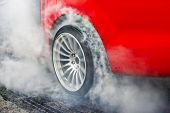 Drag Racing Car Burns Rubber Off Its Tires In Preparation For The Race poster