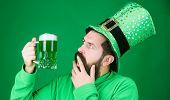 Irish You Were Beer. Hipster In Green Leprechaun Hat Holding Beer Mug. Bearded Man Toasting To Saint poster