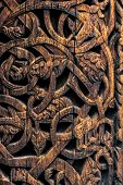 Ornaments Of Ancient Vikings On A Wooden Surface. External Wooden Wall Carved Decoration Of Medieval poster