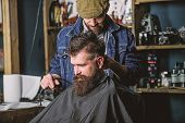 Barber With Hair Clipper Works On Haircut Of Bearded Guy Barbershop Background. Hipster Hairstyle Co poster