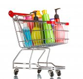 shopping cart with detergent bottles isolated on white