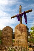 stock photo of risen  - A cross with the ten commandments in stone in front of it - JPG