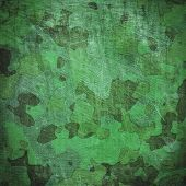 stock photo of dingy  - dingy camouflage on natural canvas - JPG