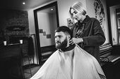 Young Woman Making Haircut For Bearded Man At Barbershop. Female Barber At Salon. Gender Equality. W poster