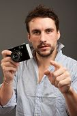Photos about sensation (paparazzi) - a young journalist holding a film camera.