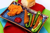 Small Portion Fried Chicken Tender with Potato Wedges and Green Bell Pepper