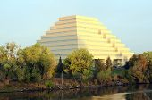 picture of ziggurat  - orange ziggurat building surrounded by trees and blue sky - JPG
