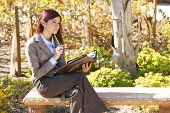 image of young adult  - A business woman thinking out of the office - JPG