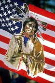 stock photo of peace-pipe  - American flag with a Native American Indian holding a peace pipe - JPG