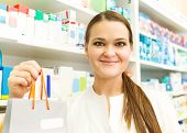 Closeup Of A Female Pharmacist Holding Packet At Drugstore